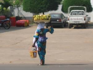 Woman carrying bananas in Kara, Togo. Photo by Sara K. Schneider, 2008.