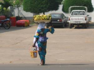 Woman carrying bananas in Kara, Togo. Photo by Sara K. Schneider, 2008.
